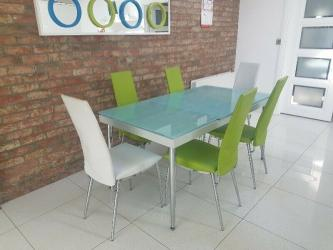 Extendedable Glass Dining Table And 5 Chairs Manufacturers in Surat